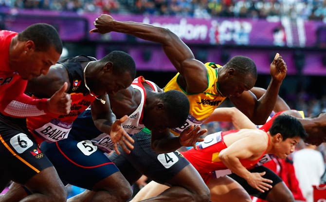 Jamaica's Usain Bolt (in yellow) starts his men's 100m semi-final. - Photo by Reuters