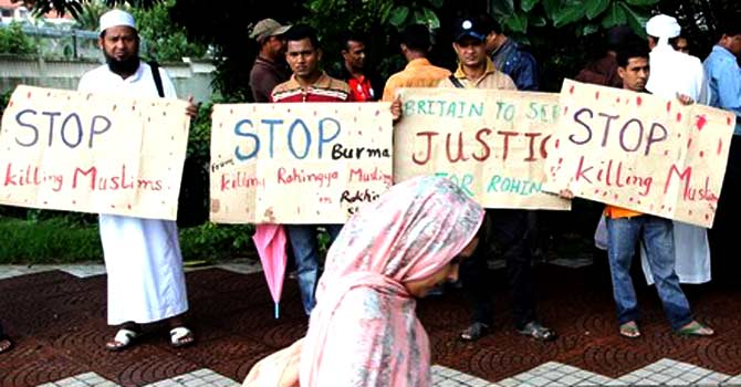 Myanmar's ethnic Rohingya Muslims display placards near the British embassy in Kuala Lumpur on July 19, 2012. Rohingya refugees protested outside the British High Commission to end violence and humanitarian crisis against Rohingya in Arakan State in Burma. — File photo by AFP