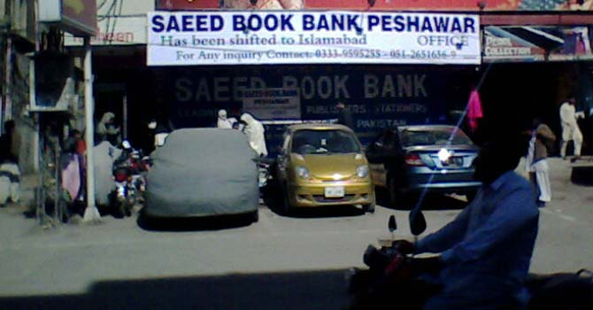 "A man on a motorbike drives past what used to be Peshawar's best-known bookstore ""Saeed Book Bank"" which has now been operating in Islamabad for a few years. – File photo courtesy Creative Commons"