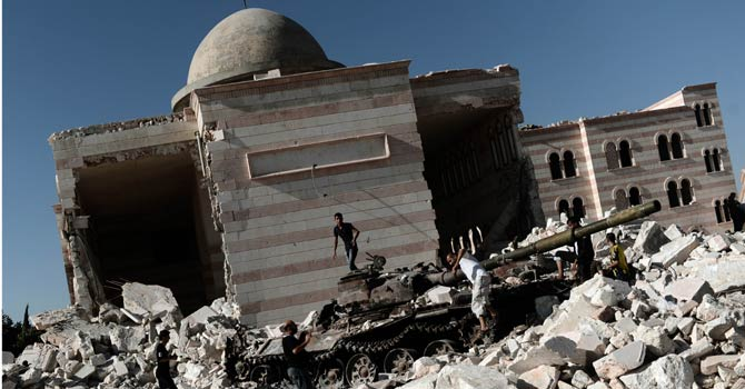 The file photo shows a building destroyed due to the conflict in Aleppo. - File Photo