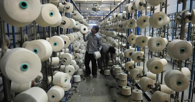 An employee at a yarn mill — File Photo