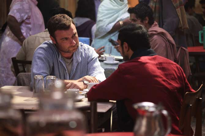 Riz Ahmed as Changez and Liev Schrieber as Bobby in a scene from the film – Photo courtesy Mirabai Films