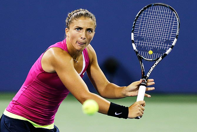 Sara Errani, of Italy, sets to return to Vera Dushevina. -Photo by Reuters