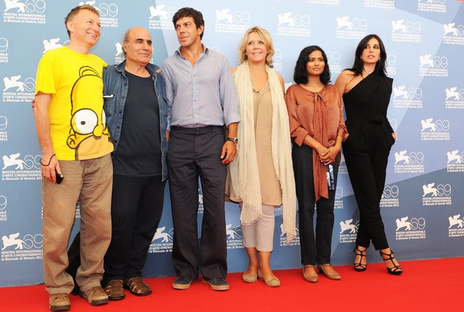 (From L) The Orizzonti jury, Milcho Manchevski, Amir Naderi, President Pierfrancesco Favino, Sandra den Hamer, Runa Islam and Nadine Labakic pose during a photocall at the festival.