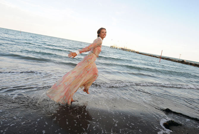The host of the festival, Polish-born actress and model Kasia Smutniak poses on the beach on the eve of the opening of the festival on August 28.