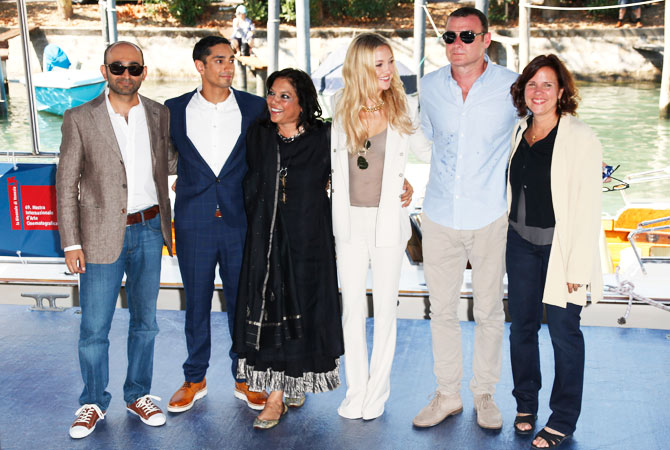 From left, writer Mohsin Hamid, actor Riz Ahmed, director Mira Nair, actors Kate Hudson, Liev Schreiber and producer Lydia Dean Pilcher arrive for the press conference of the film 'The Reluctant Fundamentalist' at the festival on Aug. 29.