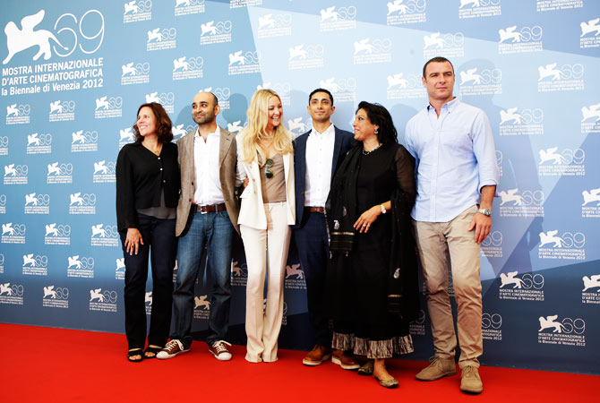 From left, producer Lydia Dean Pilcher, writer Mohsin Hamid, actress Kate Hudson, actor Riz Ahmed, director Mira Nair, and actor Liev Schreiber pose during the photo call for the movie 'The reluctant Fundamentalist' at the festival.