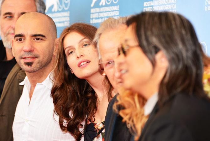 Member of Venezia 69's jury, French actress Laetitia Casta (C), poses during the photocall of the jury at the festival.