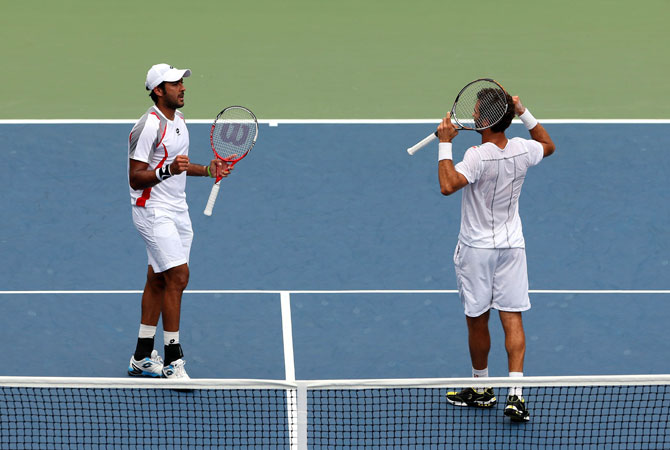 Aisam-Ul-Haq Qureshi of Pakistan and Jean-Julien Rojer of the Netherlands react against Christian Harrison and Ryan Harrison during their men's doubles quarterfinal match on Day Ten of the 2012 US Open at USTA Billie Jean King National Tennis Center on September.