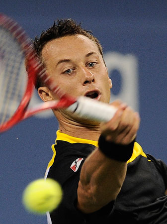 Germany's Philipp Kohlschreiber plays a shot against John Isner of the US during their 2012 US Open men's third round singles match at the USTA Billie Jean King National Tennis Center in New York on September 3, 2012.