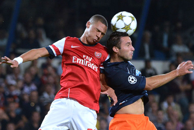 Arsenal's British defender Kieran Gibbs (Left) vies with Montpellier's Argentinian forward Emmanuel Herrera during the UEFA Champions League. Arsenal won 2-1. ? Photo by AFP