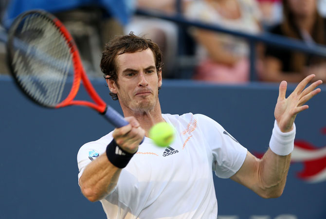 Andy Murray of Great Britain returns a shot against Marin Cilic of Croatia during their men's singles quarterfinal match on Day Ten of the 2012 US Open.
