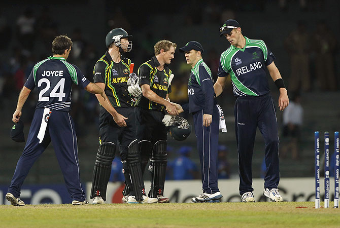 Australia's batsmen George Bailey, third from left, and Cameron White, second from left, shakes hands with Ireland's players after completing a comfortable win. -Photo by AP
