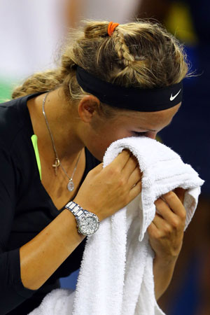 Victoria Azarenka of Belarus wipes her eyes with a towel as she cries following her defeat to Serena Williams of the United States in the women's singles final match on Day Fourteen of the 2012 US Open.