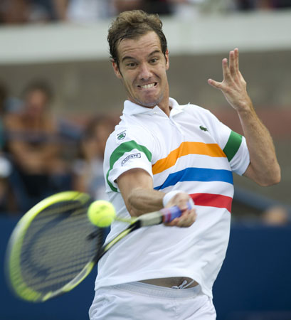 Richard Gasquet of France hits a return to Steve Johnson of the US during their men's singles third round match at the 2012 US Open tennis tournament. Gasquet won 7-6 (7/4), 6-2, 6-3.