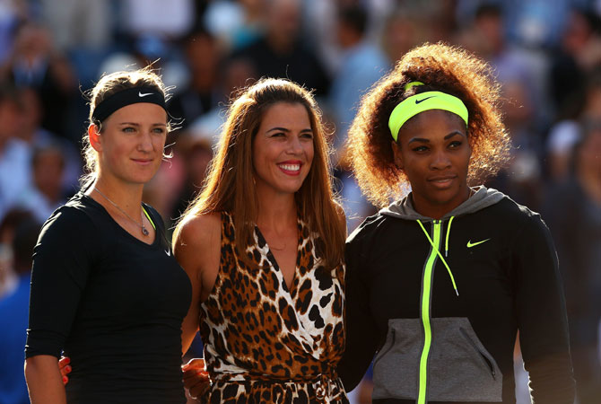 Jennifer Capriati poses with Serena Williams of the United States and Victoria Azarenka of Belarus before their women's singles final match on Day Fourteen of the 2012 US Open.