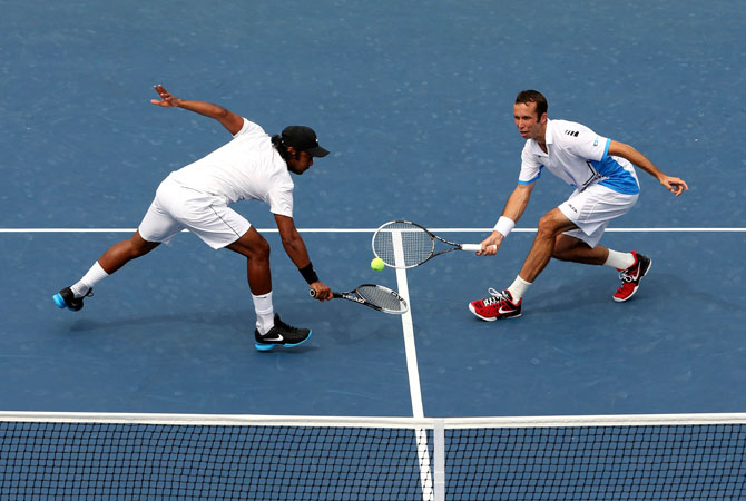 Leander Paes of India and Radek Stepanek of the Czech Republic play against Marcel Granollers and Marc Lopez of Spain during Day Eleven of the 2012 US Open.