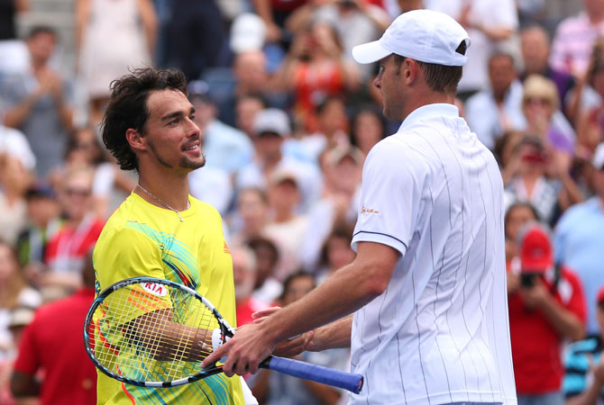 Andy Roddick of the United States shakes hands with Fabio Fognini of Italy after their men's singles third round match on Day Seven of the 2012 US Open.