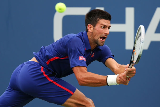Novak Djokovic of Serbia returns a shot during his men's singles fourth round match against Stanislas Wawrinka of Switzerland on Day Ten of the 2012 US.