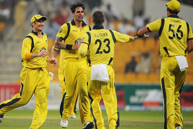 Australia celebrate after the dismissal of Nasir Jamshed. -Photo by AFP