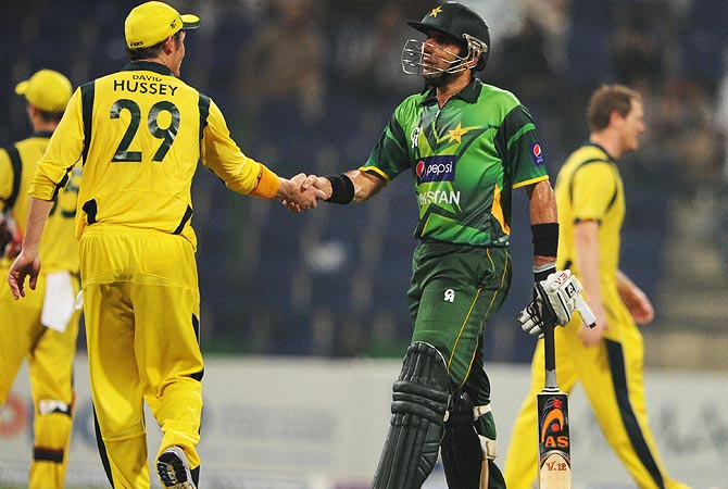 Misbah-ul-Haq shakes hands with Hussey after the match. -Photo by AFP
