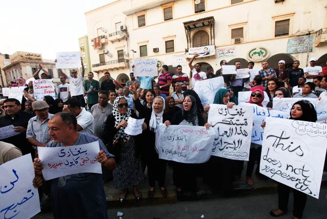 Libyan people gather in protest. ? Photo by Reuters