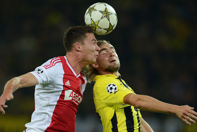 Ajax Amsterdam's forward Derk Boerrigter and Dortmund's defender Marcel Schmelzer (Right) vie for the ball during the UEFA Champions League group D. ? Photo by AFP