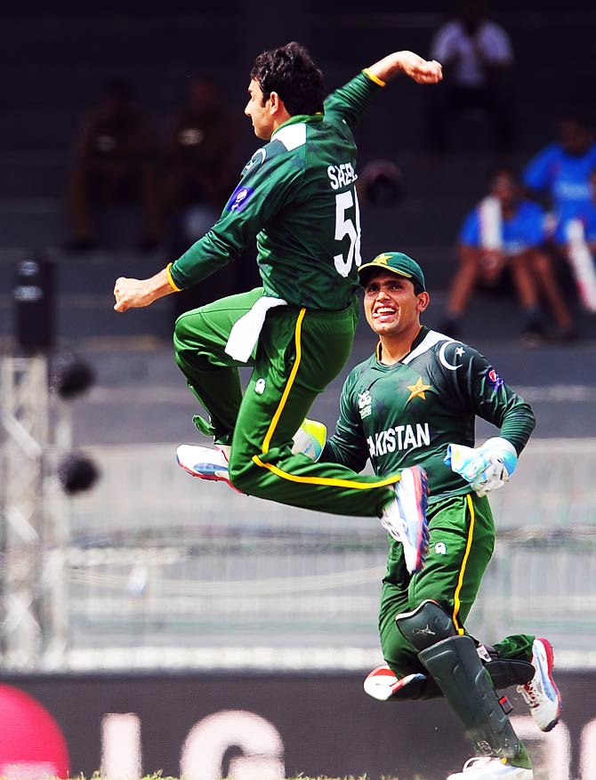 Saeed Ajmal celebrates the wicket of Indian cricketer Virender Sehwag. ? Photo by AFP