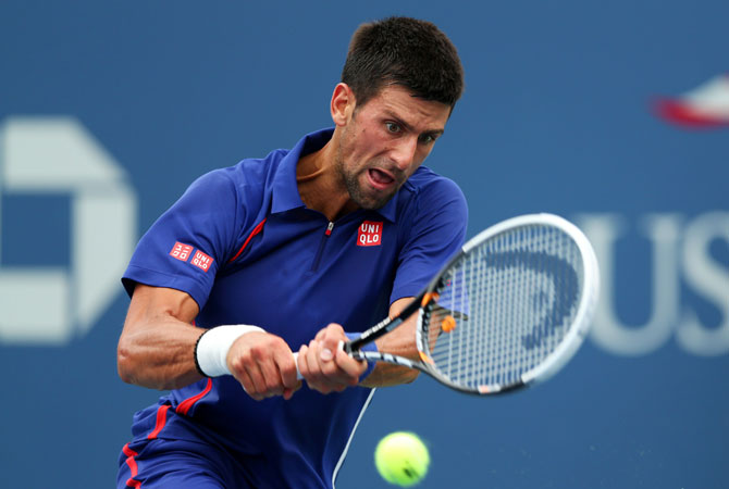 Novak Djokovic of Serbia returns a shot during his men's singles fourth round match against Stanislas Wawrinka of Switzerland on Day Ten of the 2012 US Open.