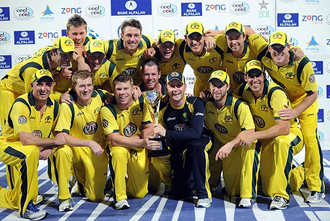 Australia pose with the trophy after winning the series 2-1. -Photo by AFP