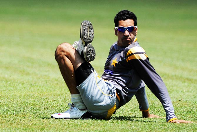 Pakistan cricketer Umar Gul stretches during an ICC Twenty20 Cricket World Cup practice session in Colombo. ? Photo by AFP
