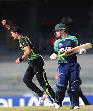 Australia's bowler Mitchel Starc (L) celebrates after he dismissed Ireland's Ed Joyce (R) during the ICC World Twenty20 Group B match between Australia and Ireland at the R. Premadasa Stadium in Colombo. -Photo by AFP