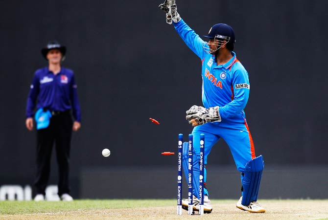 India's Captain Mahendra Singh Dhoni, right, appeals successfully for the wicket of Pakistan's batsman Imran Nazir, not seen, after breaking the stumps. ? Photo by AP