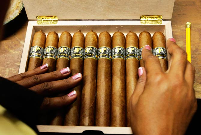 A woman fills a box of high end 'Behike 56' cigars at the Cohiba factory 'El Laguito' in Havana. ? Photo by Reuters