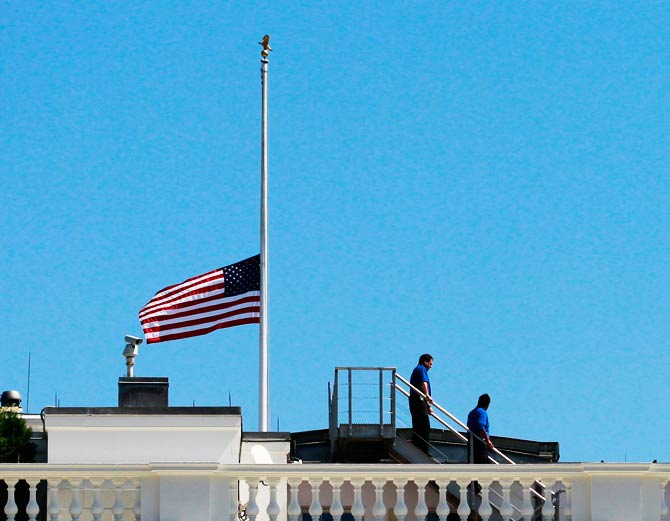 White House staff is pictured after they lowered the U.S. flag to half-staff following the death of U.S. Ambassador to Libya, Chris Stevens and others in Benghazi. ? Photo by Reuters