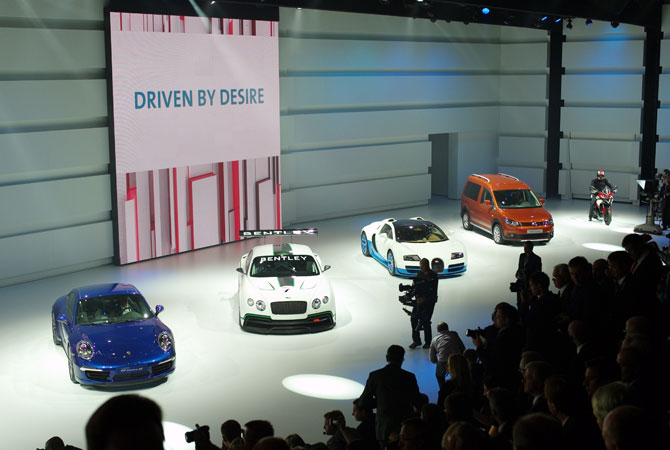 Cars are displayed at the end of the Volkswagen Group Night, in Paris, Wednesday Sept. 26, 2012, prior to the Paris Auto Show.