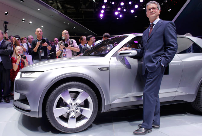Audi Chief Executive Officer Rupert Stadler poses next to an Audi Q2 on media day at the Paris Mondial de l'Automobile. – Photo by Reuters