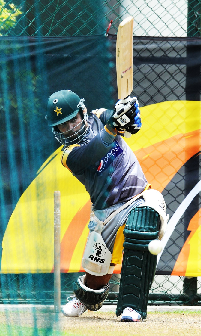 Umar Akmal bats in the nets during the training session. ? Photo by AFP