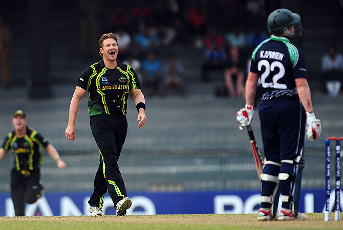 Australian all-rounder Shane Watson (C) celebrates after he dismissed Kevin O'Brien (R). -Photo by AFP