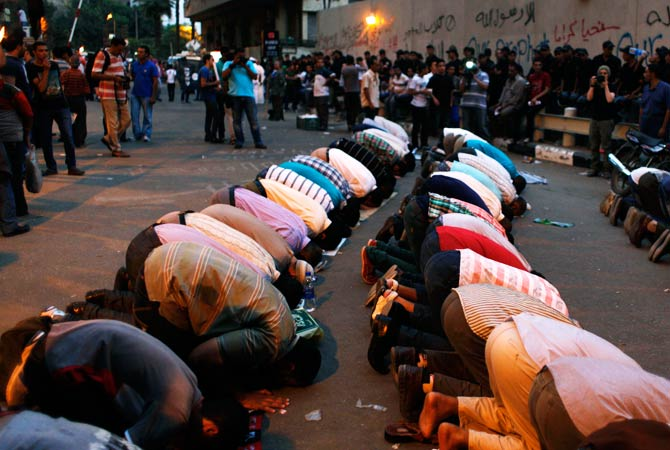 Egyptian protesters offer their evening prayers in front of the U.S embassy. ? Photo by AP