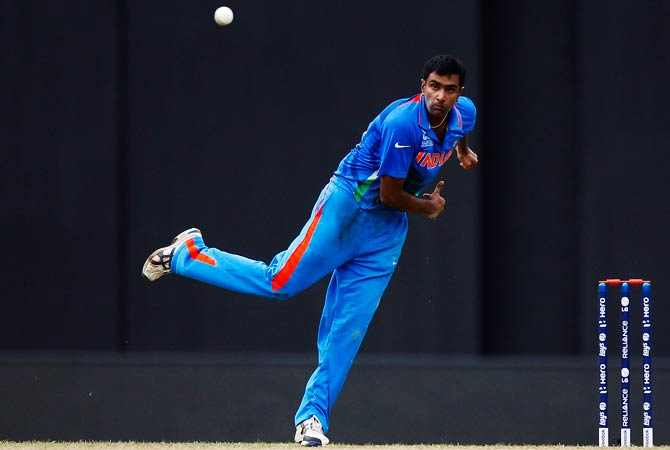 Ravichandran Ashwin bowls during their warm-up match. ? Photo by AP
