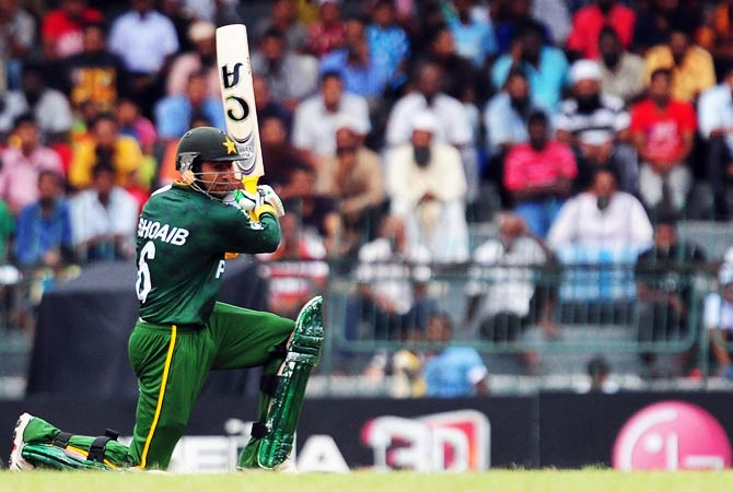 Shoaib Malik plays a shot during a World Twenty20. ? Photo by AFP