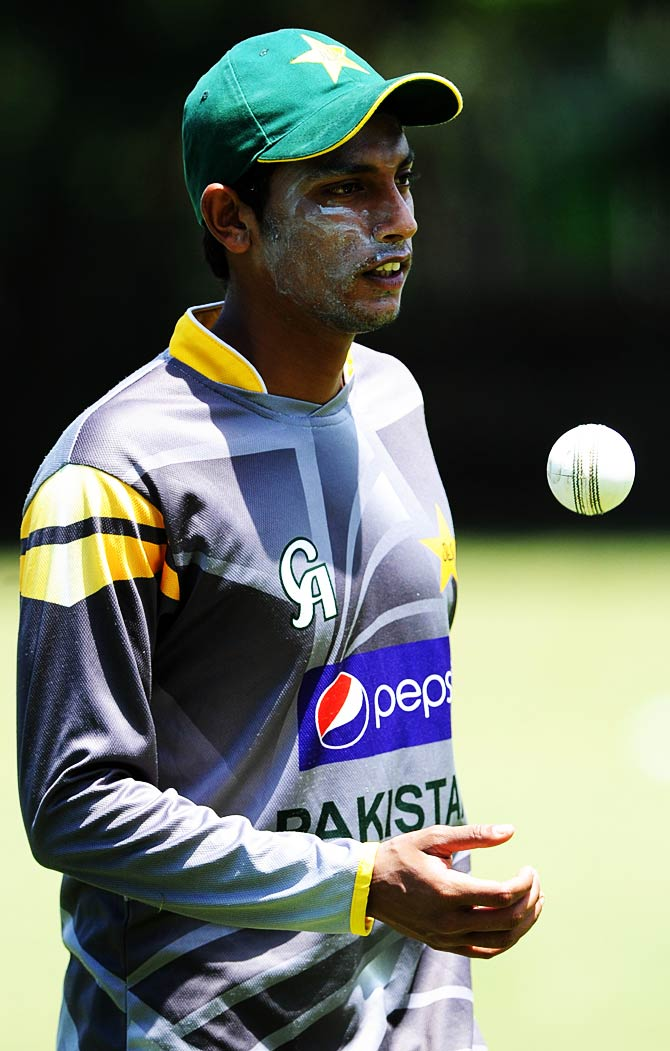 Pakistan cricketer Raza Hasan tosses a ball while practicing. ? Photo by AFP