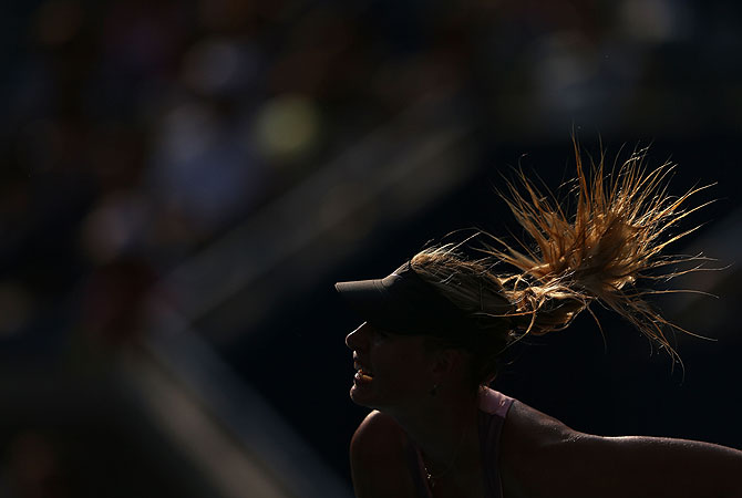 Maria Sharapova of Russia serves during her women's singles semifinal match against Victoria Azarenka of Belarus. -Photo by AFP