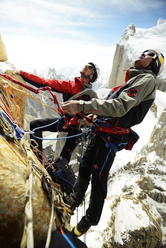 Mammut, Peter Ortner and David Lama ascend the Trango Summit in northern Pakistan's Karakoram mountain range. When they reached the summit, a camera mounted to a small remote-controlled helicopter recorded stunning images of the trio surrounded by the Karakoram range. ? Photo by AP