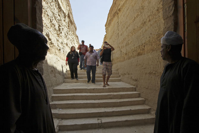 Egyptian guards wait to greet guests arriving at the entrance to the ?Serapeum?. ? Photo by AP