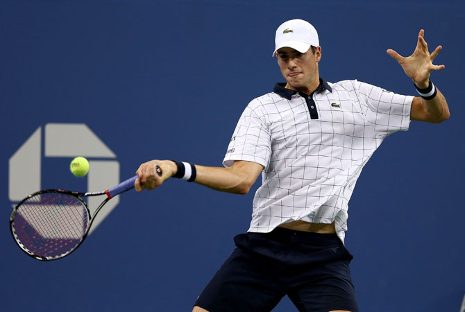 John Isner of the USA returns a shot to Phillip Kohlschreiber of Germany during Day Seven of the 2012 US Open.