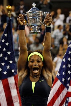 Serena Williams of the United States hugs the championship trophy after defeating Victoria Azarenka of Belarus to win the women's singles final match on Day Fourteen of the 2012 U.S. Open.
