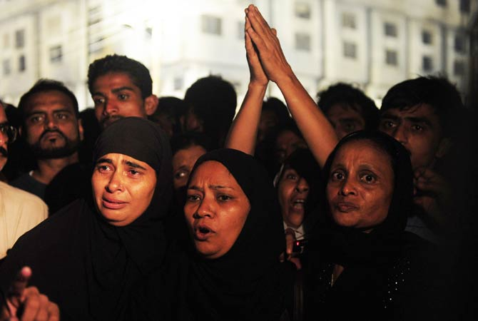 Pakistani women mourn for their families that fell victim to the factory fire. ? Photo by AFP