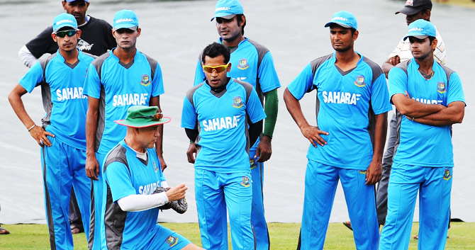 The Bangladesh team listens intently to coach Richard Pybus. ? Photo by AFP